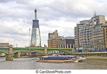 Southwark Bridge and modern buildings, London, UK