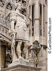 A Gargoyle in the cathedral, Milan - A Gargoyle and a statue...