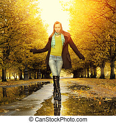 Woman at autumn walking outdoor