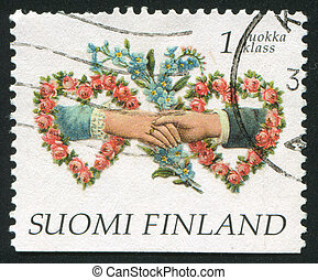 Clasping hands - FINLAND - CIRCA 1997: stamp printed by...