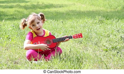 little girl play guitar