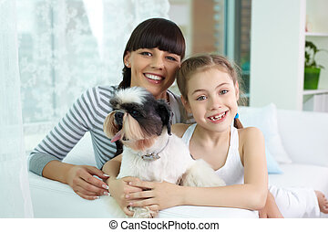 Mother, daughter and pet - Portrait of happy girl and her...