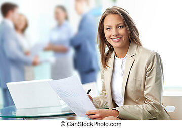 Business leader - Portrait of pretty business woman looking...