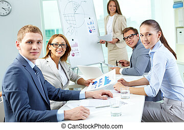 Working in group - Image of confident partners looking at...