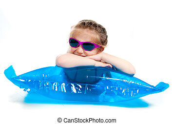 cute little girl in a swimming suit on an inflatable...