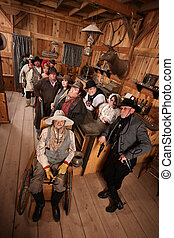 Relaxed Crowd with Guns in Saloon - Relaxed customers in old...
