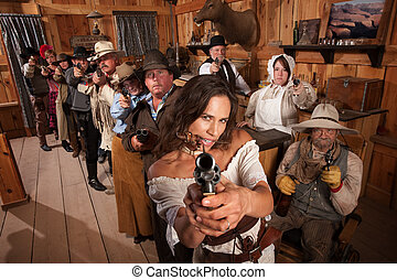 Sexy Woman Points Gun in Saloon - Pretty Indian gunfighter...