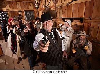 Serious Gunfighters - Serious man with old west gang holding...