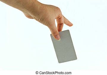 plastic bank card in his hand on a white background.
