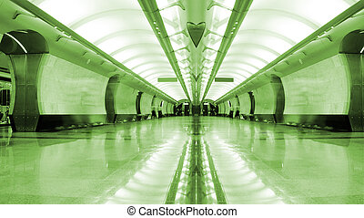 Symmetrical long corridor in metro station