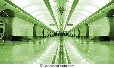 Symmetrical long corridor in metro