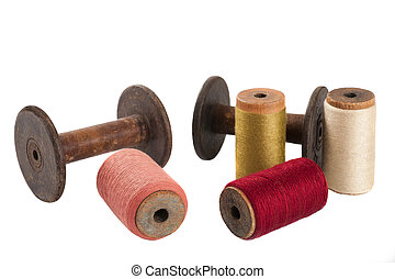 Bobbins and colored threads - Colored threads wound on...