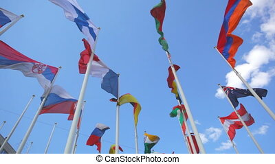 Flags of the different countries on a background of the blue...