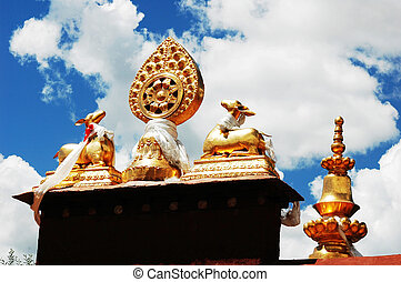 Golden Roof of a Tibetan lamasery against blue sky in Lhasa