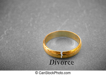 divorce concept - closeup of a gold wedding ring with a...