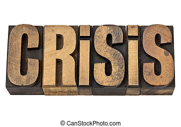 crisis word in vintage wood type