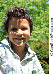 Boy outdoors - Cute little five year old boy portrait with...