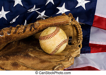 baseball and American Flag - Old baseball in glove resting...