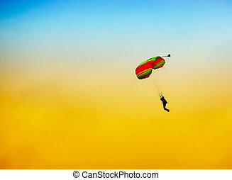 parachute against blue sky