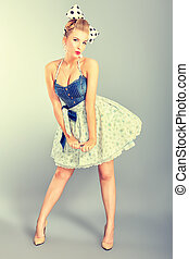 pretty female - Beautiful young woman with pin-up make-up...