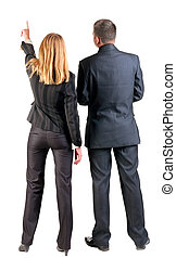 Back view of pointing business team young couple man and...