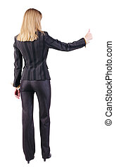 back view of standing young blonde business woman showing thumb