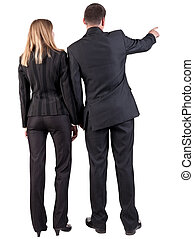Back view of pointing business team. young couple (man and...