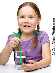 Cute little girl with a glass of water