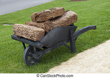 wheelbarrow with peat - landscape with wheelbarrow with peat