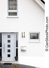 Front door of a modern house - Architectural background of...