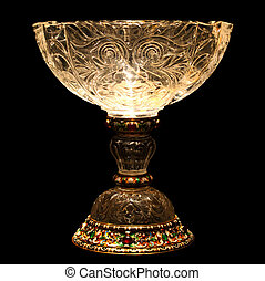 Crystal vase on a black background decorated with colored...
