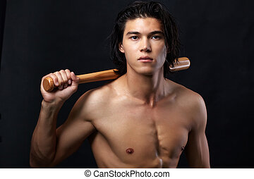 Male baseball player - Image of shirtless man with bat...