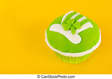 Cup cake Saint Patricks day - Green cup cake on yellow for...