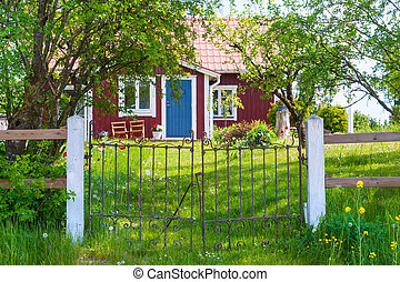 Entrance of red wooden cottage in Sweden - Entrance of a...