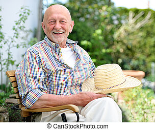 Portrait of senior man outdoors
