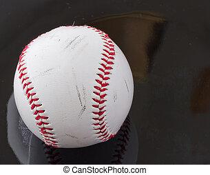 Baseball - Rugged baseball over a black reflecting surface