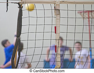 Volley net - Guys playing blurred behind a volley net in a...