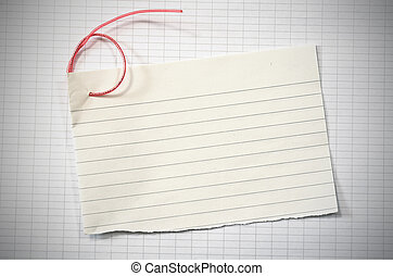 torn lined paper - torn lineed paper with red wire in shape...