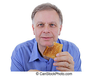 Man eating toast bread - Cheerful man eating toasted bread.