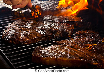 Delicious Steaks  - Steaks grilling on the barbeque