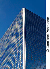 Blue Building - an office building reflecting the clear blue...
