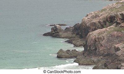 Rocky coastline with beach