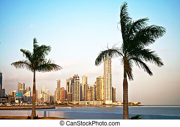 Panama City Skyline - Two palms and the ocean in front of...