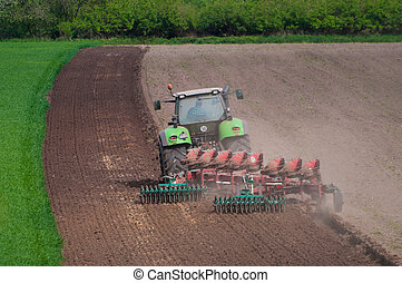 farmer ploughing field in Germany