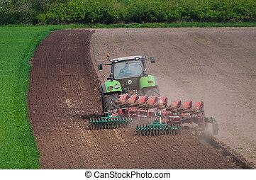 farmer ploughing field in Germany