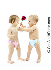 Baby boy present rose flower to a baby girl Children wear...