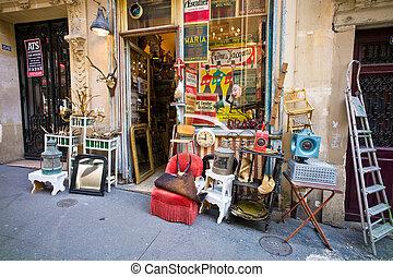 paris, france. junk shop - an antique shop in montmartre in...