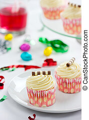 Party Time with tasty cream cupcakes candy and confetti...