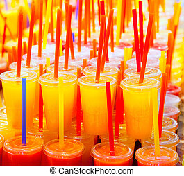 Colorful natural fresh fruits juice glasses with straw...