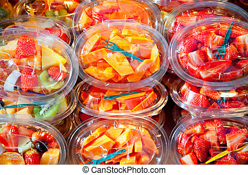 Colorful fruit salad in transparent glasses - Colorful...